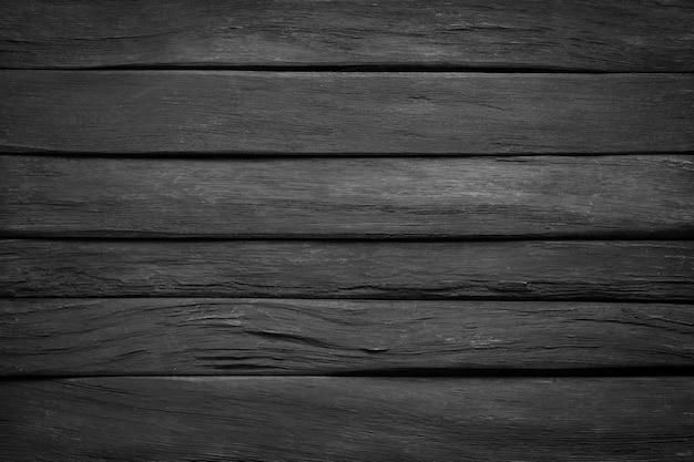 Donkere houtstructuur, bovenaanzicht. zwarte wandplanken als achtergrond