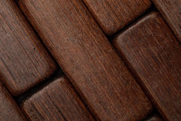 Donkere houtstructuur in de vorm van kleine rechthoeken (verzameling van natuurlijke en plantaardige vezels)