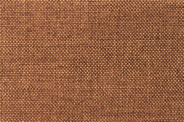 Donkere oranje dichte geweven in zakken doende stof, close-up.