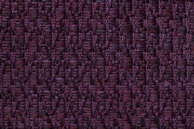 Donkere paarse gebreide wollen achtergrond met een patroon van zachte, wollige doek.