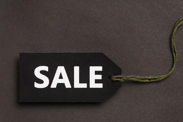 Donkere tag met verkooptitel en twist