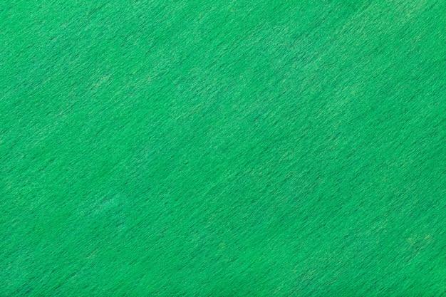 Donkere turquoise matte suède stoffenachtergrond. fluwelen textuur van vilt.