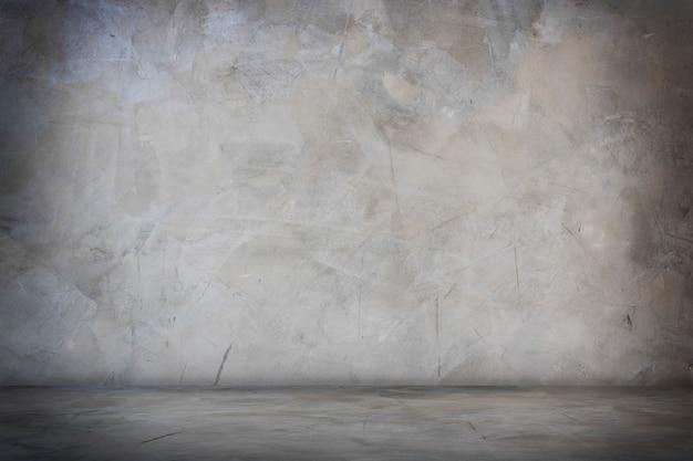 Donkere zwarte en grijze studiozaalbanner en lege cement en concrete achtergrond
