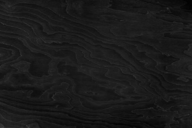 Donkere zwarte houten achtergrond. donkere houtstructuur, behang.