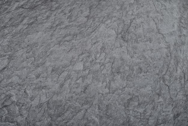 Donkere zwarte leisteen rock stenen achtergrond of textuur.