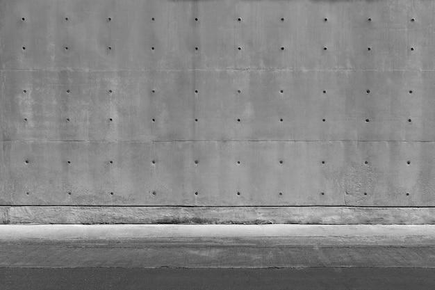 Donkergrijze concrete textuurmuur en vloer. abstracte achtergrond.