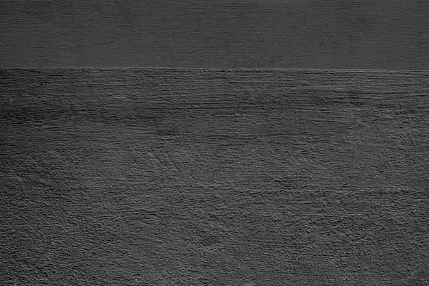 Donkergrijze effen betonnen gestructureerde achtergrond