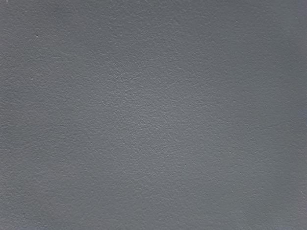 Donkergrijze getextureerde geschilderde muur