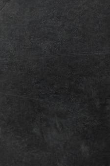 Donkergrijze grunge concrete textuur als achtergrond