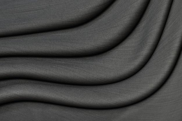Donkergrijze katoenen stoffenachtergrond