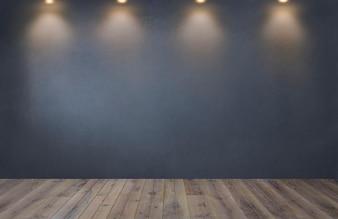 Donkergrijze muur met een rij van schijnwerpers in een lege ruimte