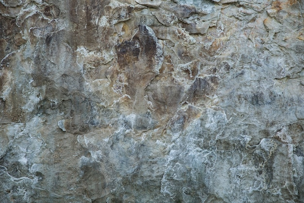 Donkergrijze rotsachtige textuur