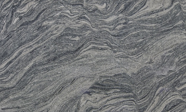 Donkergrijze steenachtergrond of textuur.