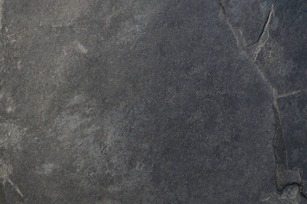Donkergrijze zwarte leiachtergrond of textuur. zwarte steen