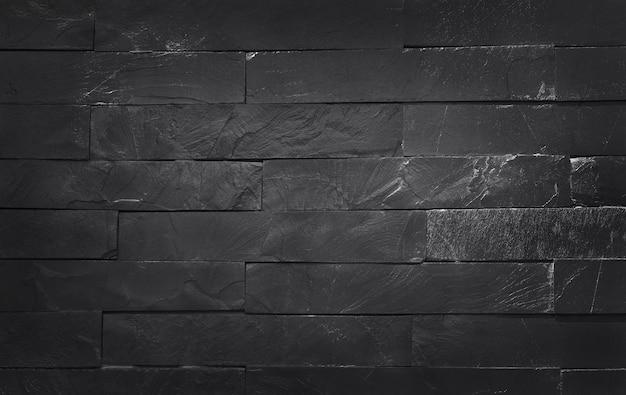 Donkergrijze zwarte leisteentextuur met hoge resolutie, patroon van stenen bakstenen muur en designkunstwerk.