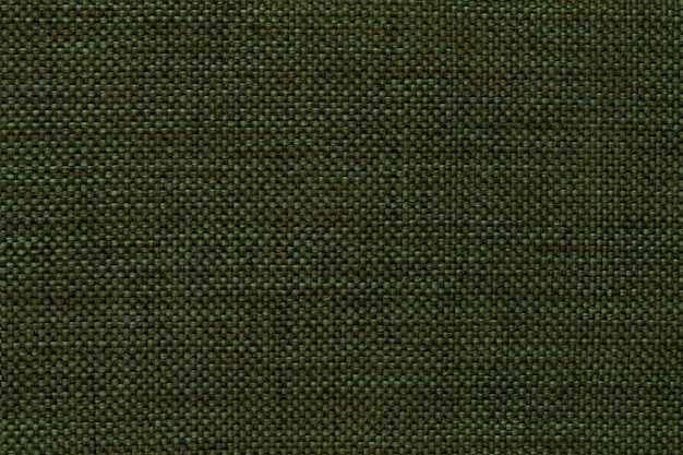 Donkergroene dichte geweven in zakken doende stof, close-up.