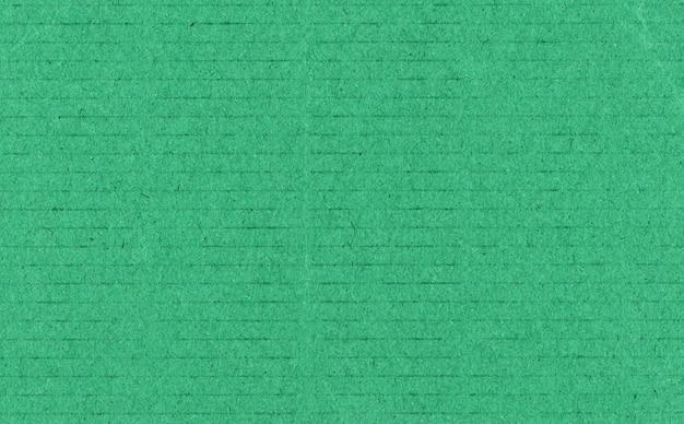Donkergroene kartonnen textuurachtergrond