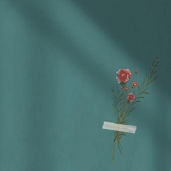 Donkergroene muurschaduwachtergrond met bloemdecoratie