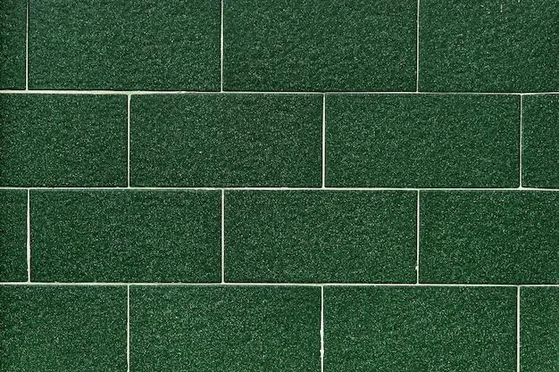 Donkergroene tegels patroon behang