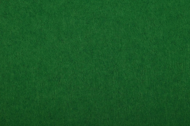Donkergroene vilt achtergrondstructuur close-up