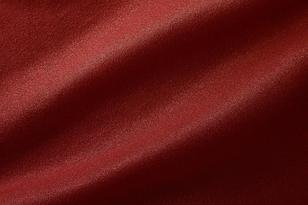 Donkerrode stoffendoektextuur voor achtergrond en ontwerpkunstwerk, mooi verfrommeld patroon van zijde of linnen.