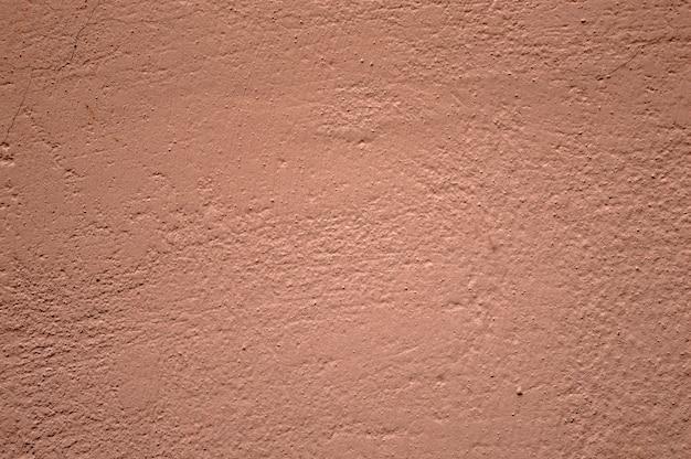 Donkerroze geschilderd op cement, muur, achtergrond