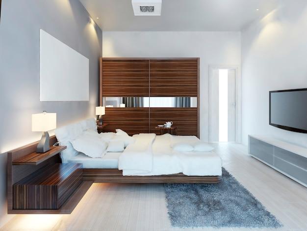 Door de inrichting van moderne lichte slaapkamer voorzien van een grote schuifkast. het idee van bruine meubels in een witte slaapkamer, een luxe oplossing. 3d render.
