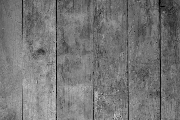 Doorstane houten plankomheining, houten textuur als achtergrond