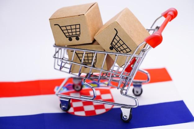 Doos met winkelwagen logo en kroatië vlag.
