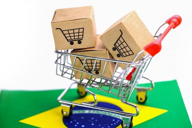 Doos met winkelwagen logo en vlag van brazilië