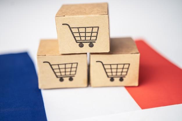 Doos met winkelwagenlogo en vlag van frankrijk.