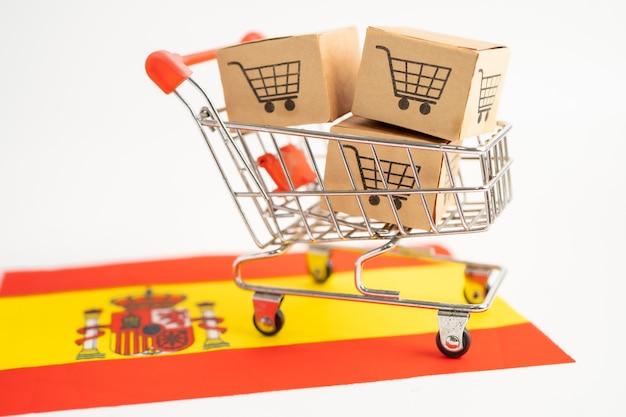 Doos met winkelwagenlogo en vlag van spanje import export online winkelen