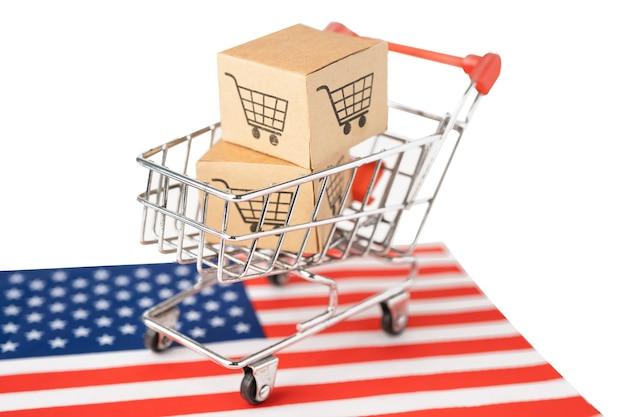 Doos met winkelwagenlogo en vlag van usa america.