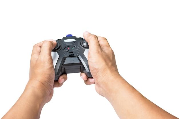 Draadloze joystickcontroller ter beschikking voor het spelen van spel of stuk speelgoed controle die op wit wordt geïsoleerd
