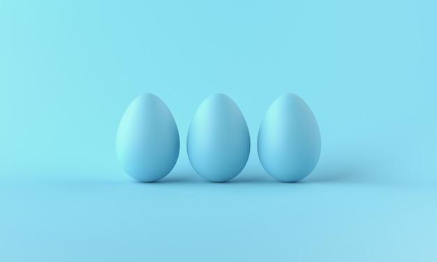 Drie blauwe kippeneieren op blauwe achtergrond. wenskaart van happy easter day. kopieer ruimte. 3d-weergave