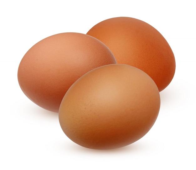 Drie bruin kippenei geïsoleerd