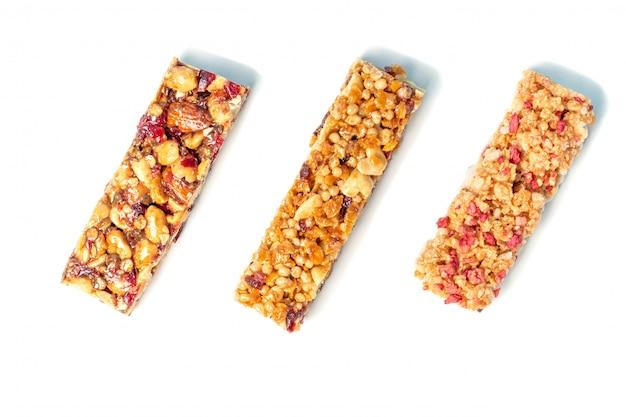 Drie eiwitrepen met geïsoleerde granen