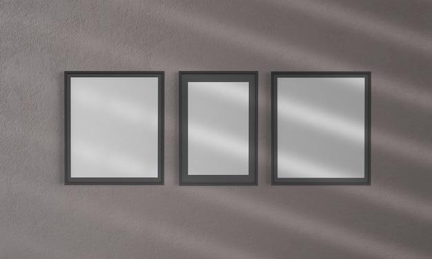 Drie frames op een muur mockup 3d-rendering