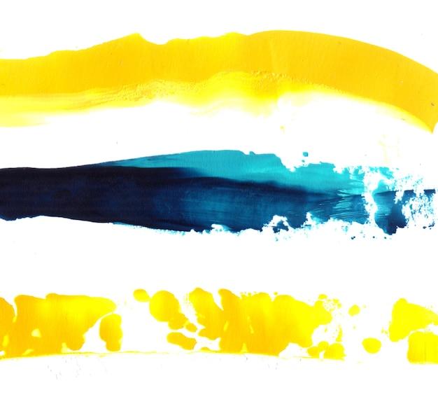 Drie gele en blauwe verfstreken artistieke textuur
