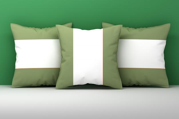 Drie grote kussens van gren wit textiel