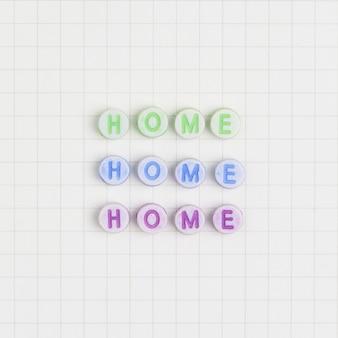 Drie keer home kralen tekst typografie