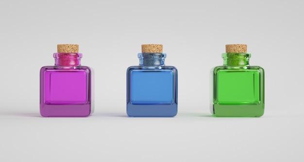 Drie kleurrijke glazen potten met kurk stop.