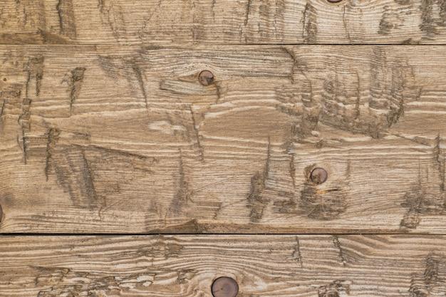 Drie oude houten planken bedekt met een beschermend middel achtergrond