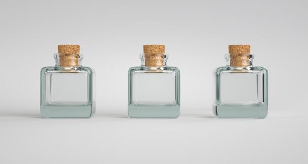 Drie vierkante glazen containers met een kurken stop.