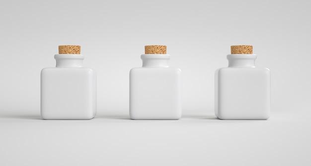Drie vierkante porseleinen potten met een kurken stop.