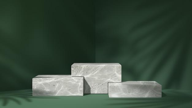 Drie wit marmeren doospodium voor productplaatsing op de achtergrond van schaduwbladeren
