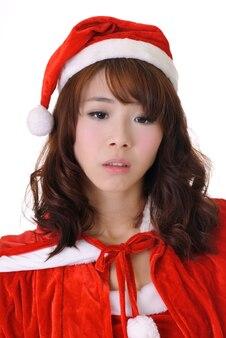 Droevig kerstmismeisje, het portret van de halve lengteclose-up op witte muur.