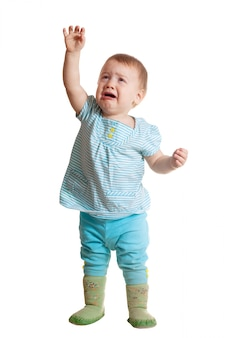 Droevige baby over wit Gratis Foto
