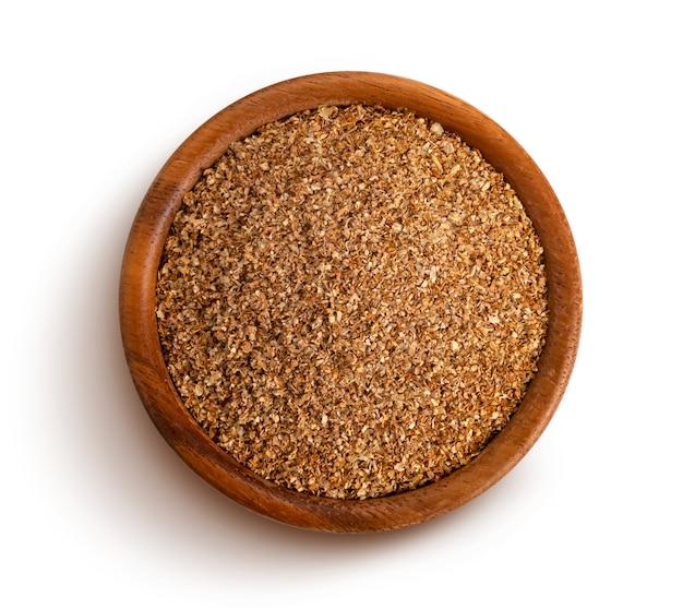 Droge plantaardige vezel in houten kom
