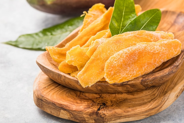 Droog mango fruit hoop textuur oppervlaktepatroon gedroogd mango plakje snoep fruit gedehydrateerd patroon oppervlak